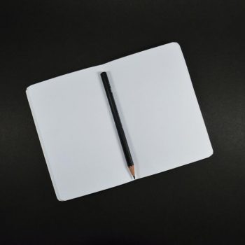 A notebook and a pencil - possibly used by guest blog authors to write with