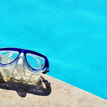 Diving mask next to a swimming pool - could be used to jump into a talent pool