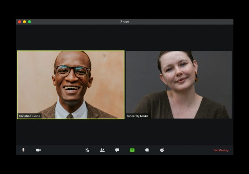 Screenshot of two people on a Zoom call to illustrate remote interviews